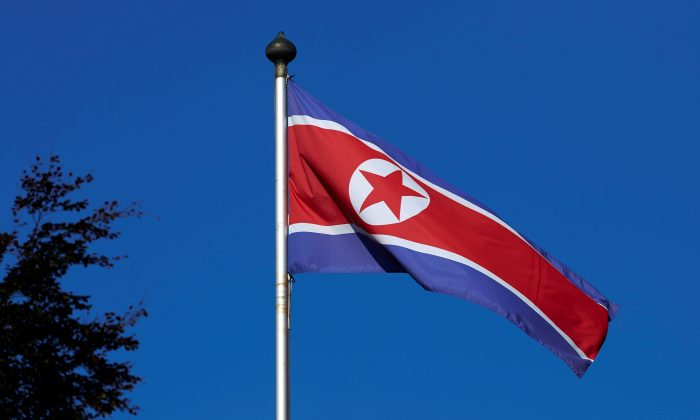 A North Korean flag flies on a mast at the Permanent Mission of North Korea in Geneva October 2, 2014.   (Reuters/Denis Balibouse/File Photo)