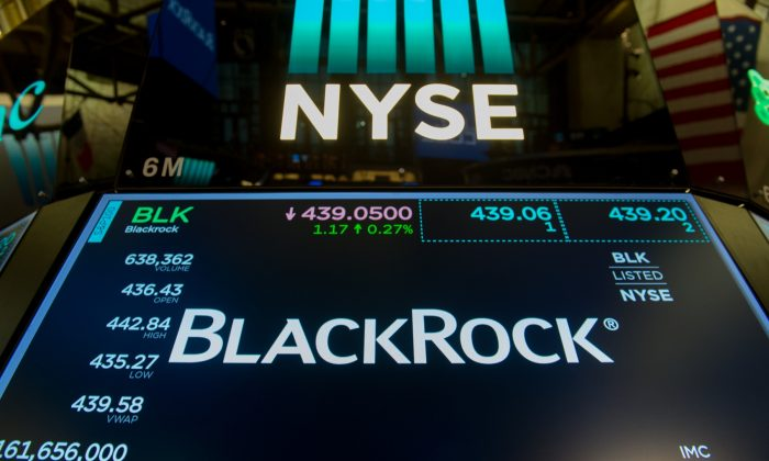 BlackRock stock at the New York Stock Exchange on July 14. BlackRock, the world's biggest asset manager with $5.7 billion in AUM, announced it will absorb research costs on behalf of clients under MiFID II. (Bryan R. Smith/AFP/Getty Images)