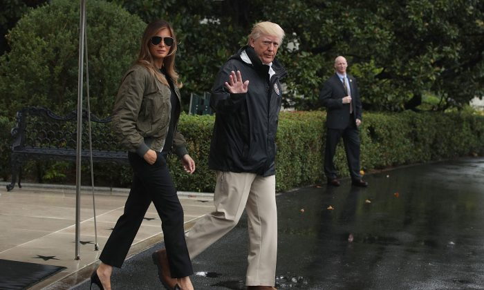 President Donald Trump walks with first lady Melania Trump to Marine One at the White House on Aug. 29, 2017. (Alex Wong/Getty Images)