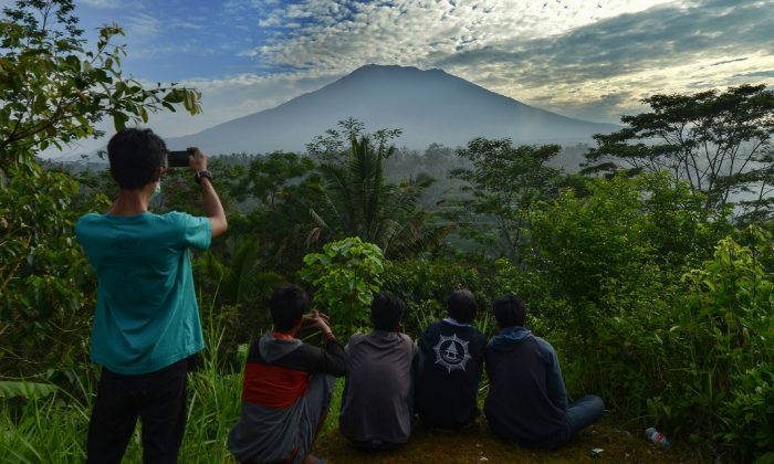 People look at Mount Agung on the Indonesian resort island of Bali on Sept. 24, 2017. Hundreds of small tremors stoked fears it could erupt for the first time in more than 50 years. (Sonny Tumbelaka/AFP/Getty Images)