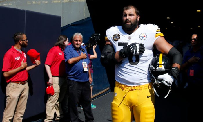 Alejandro Villanueva #78 of the Pittsburgh Steelers stands by himself in the tunnel for the national anthem prior to the game against the Chicago Bears on September 24, 2017 in Chicago, Illinois. (Photo by Joe Robbins/Getty Images)