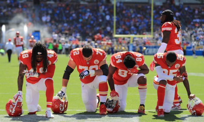 Terrance Smith No. 48, Eric Fisher No. 72, Demetrius Harris No. 84, and Cameron Erving No. 75 of the Kansas City Chiefs are seen taking a knee before the game against the Los Angeles Chargers at the StubHub Center on Sept. 24, 2017 in Carson, Calif. (Sean M. Haffey/Getty Images)
