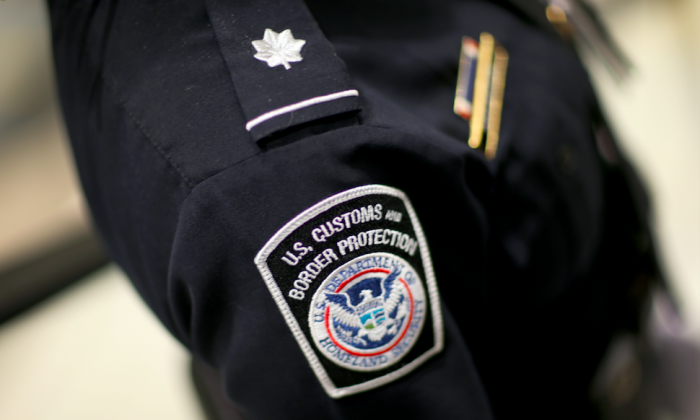 A U.S. Customs and Border Protection agent. New travel restrictions announced Sept. 24, 2017, will bar almost all citizens from seven countries to the United States indefinitely. (Joe Raedle/Getty Images)