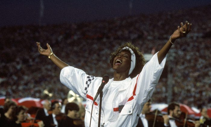 Whitney Houston sings the National Anthem before a game with the New York Giants taking on the Buffalo Bills prior to Super Bowl XXV at Tampa Stadium in Tampa, Florida, on Jan. 27, 1991. The Giants won 20-19. (George Rose/Getty Images)