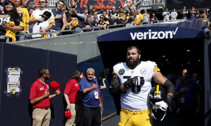 Alejandro Villanueva of the Pittsburgh Steelers stands by himself in the tunnel for the national anthem prior to the game against the Chicago Bears at Soldier Field in Chicago on Sept. 24, 2017. (Joe Robbins/Getty Images)