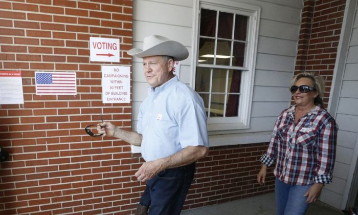 Alabama Republican U.S. Senate candidate Roy Moore and wife Kayla leave the Gallant Fire Hall after voting in today's GOP runoff election September 26, 2017 in Gallant, Alabama. (Hal Yeager/Getty Images)