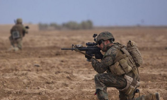 A U.S. Marine during an active combat operation. (Public Domain)