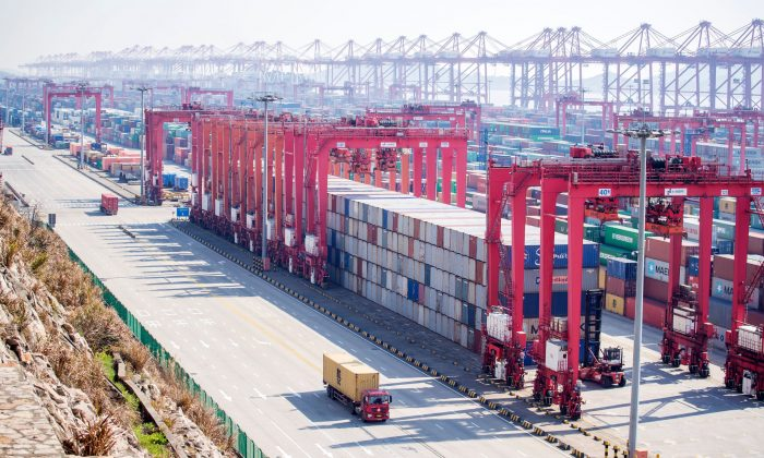 Containers with Chinese goods are organized for trade at the Yangshan Deep Water Port in Shanghai on Feb. 13, 2017. (Johannes Eisele/AFP/Getty Images)
