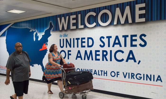 International travelers leave the Customs and Immigration area of Dulles International Airport in Dulles, Va., on June 29, 2017. (Paul J. Richards/AFP/Getty Images)