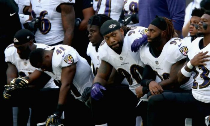 Baltimore Ravens players kneel for the American national anthem during the NFL International Series match between Baltimore Ravens and Jacksonville Jaguars at Wembley Stadium on Sept. 24, 2017, in London, England.  (Alex Pantling/Getty Images)