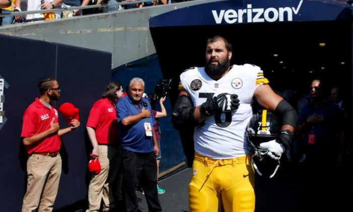 Alejandro Villanueva #78 of the Pittsburgh Steelers stands by himself in the tunnel for the national anthem prior to the game against the Chicago Bears on September 24, 2017, in Chicago, Illinois. (Joe Robbins/Getty Images)