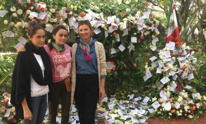 María Limón, Dafne Tovar, and Olivia Bloch stand beside part of the memorial they have created in Parque México to honour those lost to the quake on Sept 26, 2017. (Anthony Hoffman)
