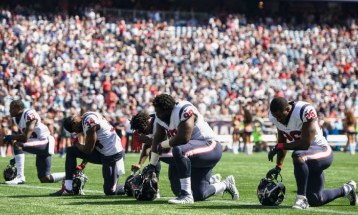 Members of the Houston Texans kneel before a game against the New England Patriots at Gillette Stadium in Foxboro, Massachusetts, on Sept. 24, 2017. (Billie Weiss/Getty Images)