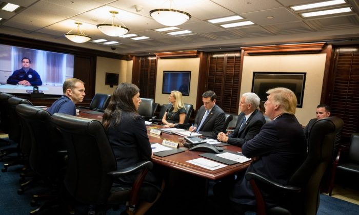 President Donald Trump, joined by Vice President Mike Pence (2nd R), White House Homeland Security Adviser Tom Bossert (3rd R); Acting U.S. Secretary of Homeland Security Elaine Duke (2nd L), and FEMA Administrator Brock Long,(L), speaks with Puerto Rico's Gov. Ricardo A. Rosselló on a video teleconference in the Situation Room at the White House on Sept. 26, 2017. (Official White House Photo by Shealah Craighead)