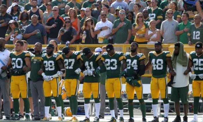 Members of the Green Bay Packers stand with arms locked as a sign of unity during the national anthem prior to their game against the Cincinnati Bengals at Lambeau Field on Sept. 24, 2017, in Green Bay, Wis.  (Dylan Buell/Getty Images)