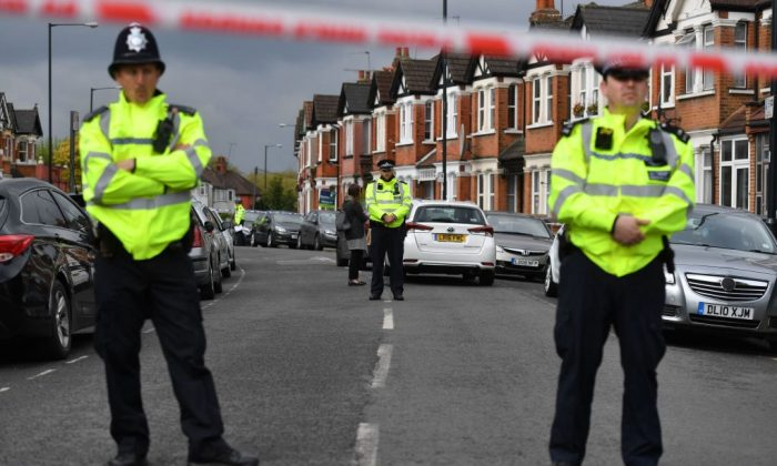 British police officers secure a cordon in a residential street in north-west London on April 28, 2017. (Ben Stansall/AFP/Getty Images)