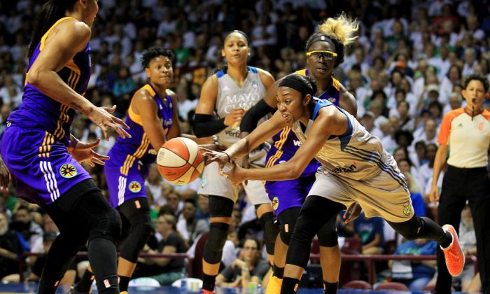 Renee Montgomery No. 21 of the Minnesota Lynx drives against the Los Angeles Sparks players Essence Carson No. 17, Alana Beard No. 0, and Candace Parker No. 3 while Maya Moore No. 23 of the Minnesota Lynx watches during the fourth quarter of Game One of the WNBA finals at Williams Arena on Sept. 24, 2017, in Minneapolis, Minn.(Andy King/Getty Images)