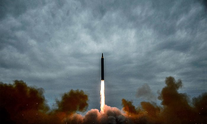 A launch test of North Korea's intermediate-range ballistic missile Hwasong-12 at an undisclosed location near Pyongyang, in a photo released by North Korea's official Korean Central News Agency on Aug. 30. (STR/AFP/Getty Images)