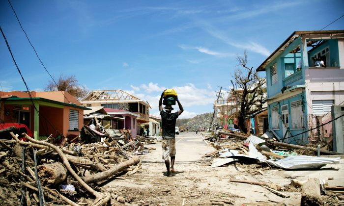 A man walks amid destruction in Roseau, the capital of Dominica, after Hurricane Maria damages the island, on September 23, 2017. (Cedrick Isham Calvados/AFP/Getty Images)