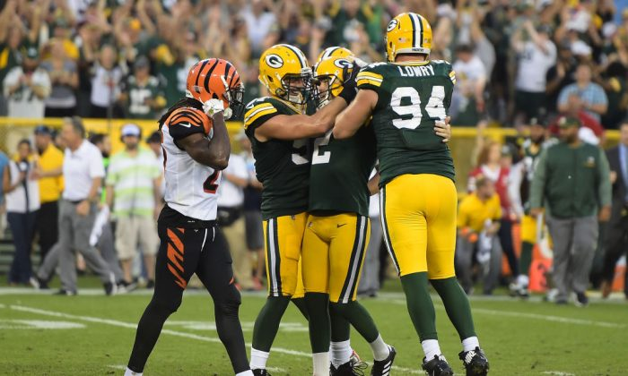 Mason Crosby No. 2 of the Green Bay Packers celebrates after kicking the game winning field goal in overtime against the Cincinnati Bengals at Lambeau Field on Sept. 24, 2017 in Green Bay, Wis.  (Stacy Revere/Getty Images)