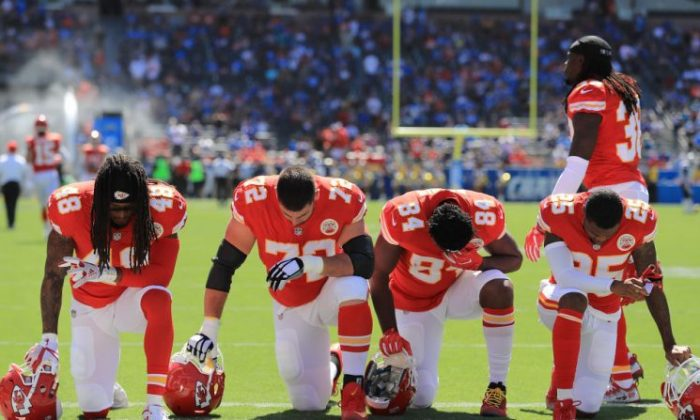 Terrance Smith No. 48, Eric Fisher No. 72, Demetrius Harris No. 84, and Cameron Erving No. 5 of the Kansas City Chiefs are taking a knee before the game against the Los Angeles Chargers at the StubHub Center on Sept. 24, 2017, in Carson, Calif.  (Sean M. Haffey/Getty Images)