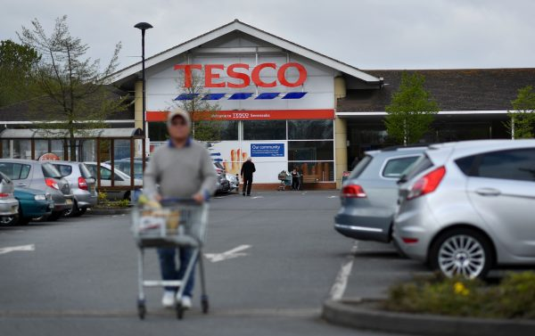 A customer pushes a shopping trolley as he walks through the car park of a Tesco store in Sevenoaks, south-east of London on April 12, 2017.  (Ben Stansall/AFP/Getty Images)