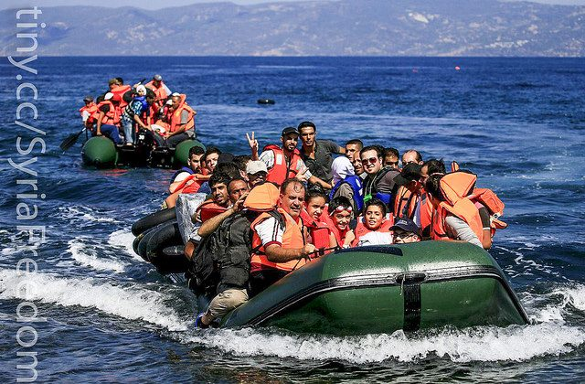 Syrian Refugees in plastic boats struggling to reach the coast. (Freedom House\Flicker, Public Domain)