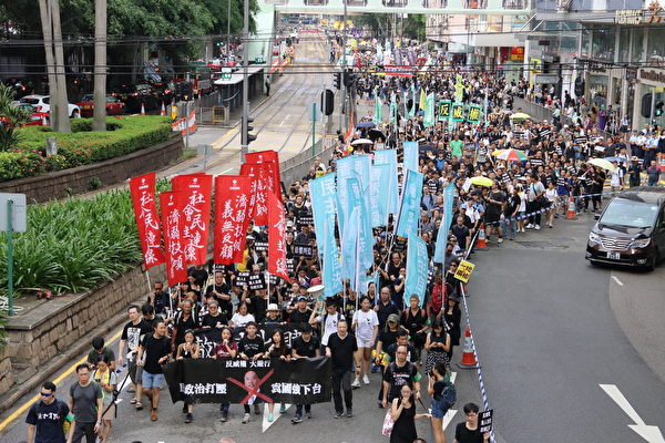 Hong Kong residents took to the streets to protest the Chinese Communist Party's rule on Oct. 1, the anniversary of the Party's takeover of China. (Cai Wenwen/The Epoch Times)