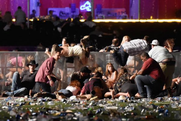 People scramble for shelter at the Route 91 Harvest country music festival