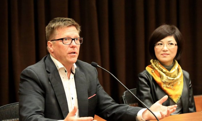 "Michel Juneau-Katsuya, a former CSIS senior manager, and filmmaker Doris Liu take part in a panel discussion following the screening of Liu's documentary ""In the Name of Confucius"" during Ottawa's One World Film Festival on Sept. 30, 2017. (Jonathan Ren/The Epoch Times)"