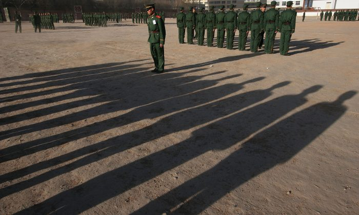 Army recruits training at a base in Xining, Qinghai Province, China, on December 26, 2005. (China Photos/Getty Images)