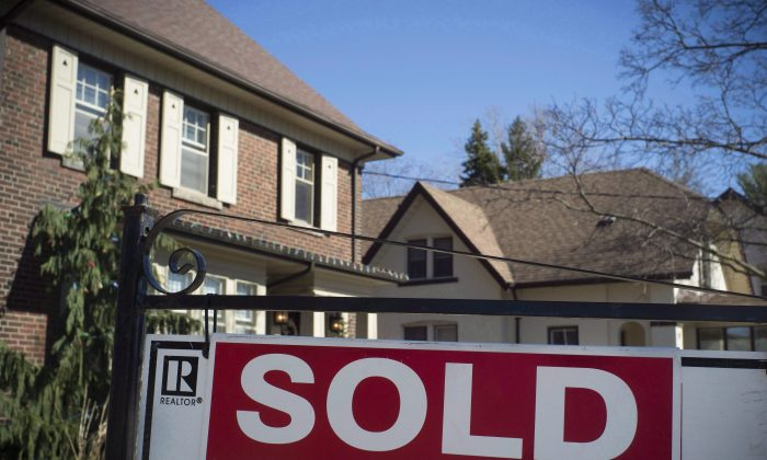 A sold sign is shown in front of a west-endToronto home. The average price of a home sold in theTorontoarea in September 2017 climbed higher on a month-over-month basis for the first time since hitting a record in April. (The Canadian Press/Graeme Roy)