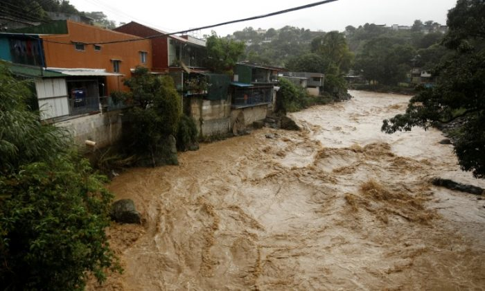 The flooded Tiribi river is seen during heavy rains of Tropical Storm Nate that affects the country in San Jose, Costa Rica October 5, 2017. (REUTERS/Juan Carlos Ulate)