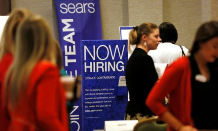 Recruiters and job seekers are seen at a job fair in Golden, Colorado, June 7, 2017. (REUTERS/Rick Wilking)