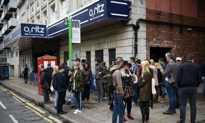 Music fans wait outside the O2 Ritz venue in Manchester. (Oli Scarff/AFP/Getty Images)