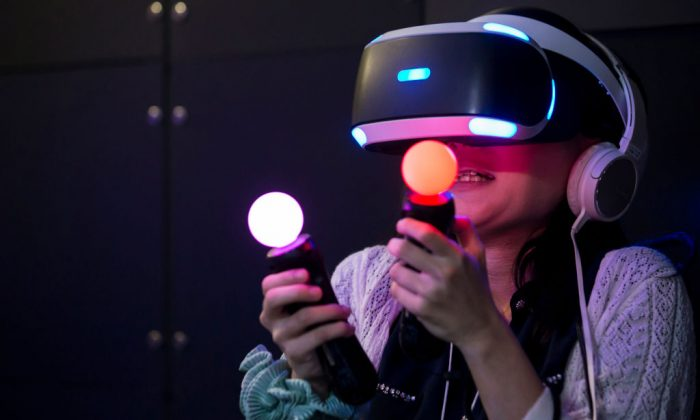 A visitor wearing a PlayStation VR headset plays a video game at the Tokyo Game Show 2017. (Photo by Tomohiro Ohsumi/Getty Images)