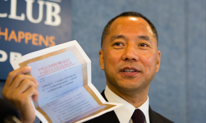 Chinese billionaire Guo Wengui holds photocopies of documents allegedly on Chinese national security council request to send more spies to the United States and other specific goals, at a press conference on Chinese Kleptocracy at the National Press Club in Washington, on Oct. 5, 2017. (Samira Bouaou/The Epoch Times)