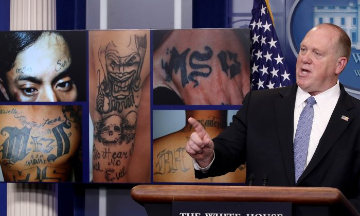 Tom Homan, acting director of Immigration and Customs Enforcement, answers questions in front of gang related photos from the MS-13 gang during a daily briefing at the White House in Washington on July 27, 2017. (Win McNamee/Getty Images)