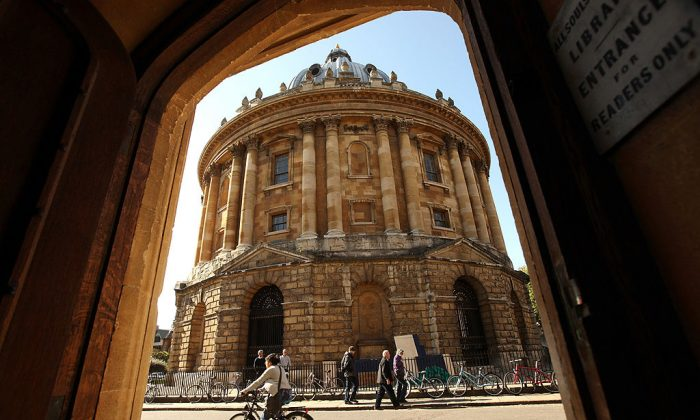 A cyclist travels past the Radcliffe Camera building of Oxford University in Oxford city centre. (Oli Scarff/Getty Images)
