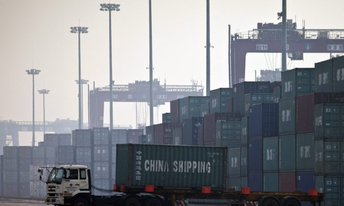 A truck transports a container to be loaded onto a ship at a port in Tianjin, China in this undated photo. (Alexander F. Yuan/AP Photo)