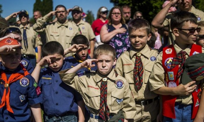 In this Monday, May 29, 2017 file photo, Boy Scouts and Cub Scouts salute during a Memorial Day ceremony in Linden, Mich. On Wednesday, Oct. 11, 2017. (Jake May/The Flint Journal - MLive.com via AP)