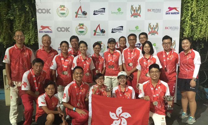 MEDAL FOR EVERYONE – A happy Hong Kong team proudly displaying their medals won at the Asian Lawn Bowls Championship in India.  Hong Kong took two golds, four silvers and six bronze at the competition. (HKLBA)