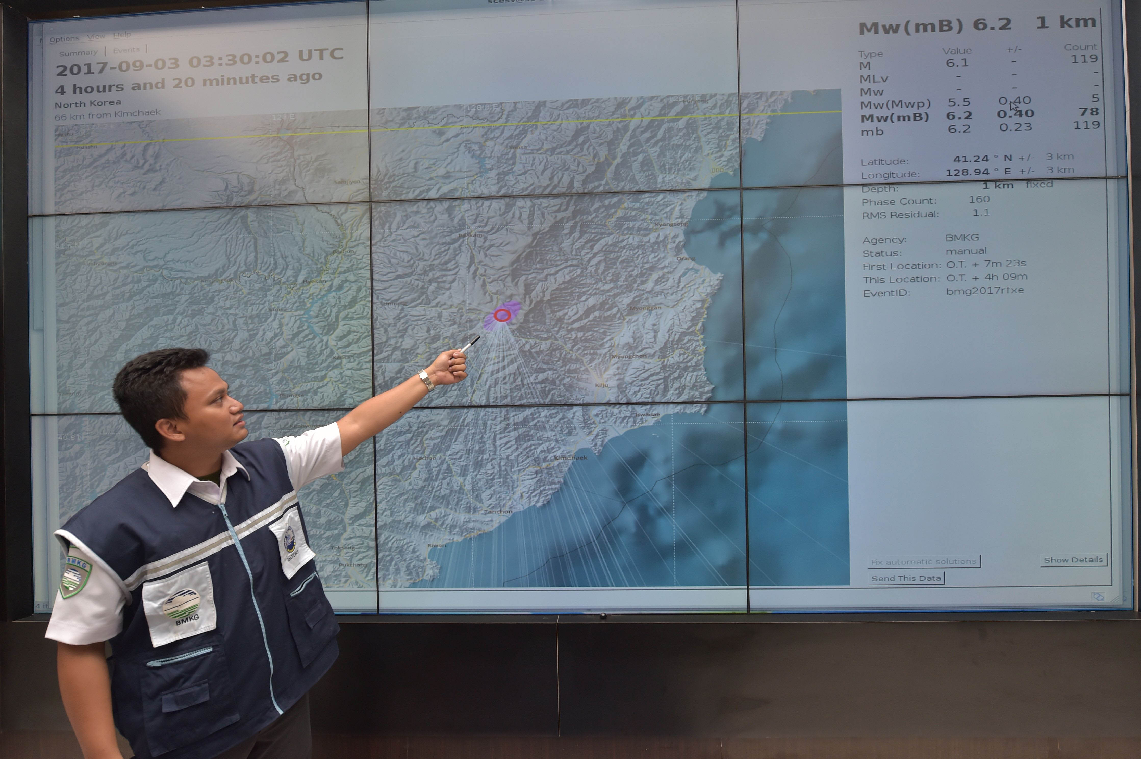 An Indonesian official at Indonesia's Meterological, Climatological and Geophysical Agency (BMKG) points to a map of North Korea showing where the agency recorded a 6.2 magnitude earthquake caused by a North Korean nuclear test on September 3, 2017. (Adek Berry/AFP/Getty Images)