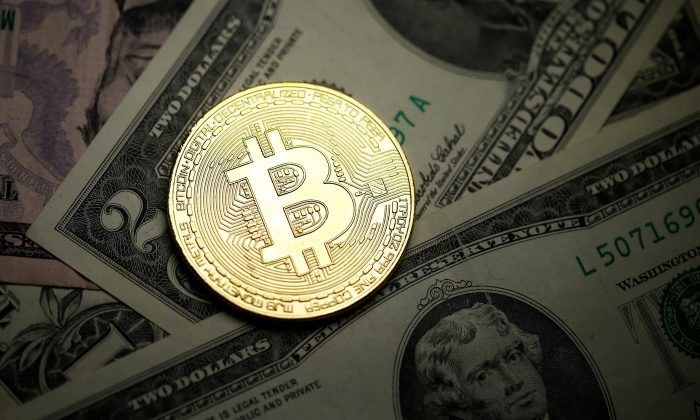 Bitcoin is more volatile than other currencies but less than its crypto competitors. (Reuters/Dado Ruvic/Illustration)