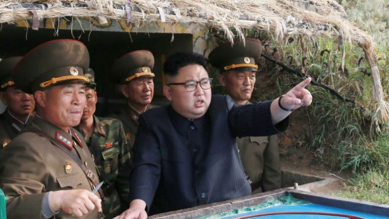 This undated picture released from North Korea's official Korean Central News Agency (KCNA) on May 5, 2017 shows North Korean leader Kim Jong-Un (C) inspecting the defense detachment on Jangjae Islet and the Hero Defense Detachment on Mu Islet located in the southernmost part of the waters off the southwest front. (AFP/Getty Images)
