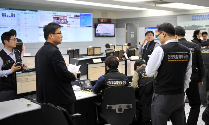Members of the Korea Internet Security Agency (KISA) check on cyber attacks at a briefing room in Seoul on March 20, 2013. (Jung Yeon-Je/AFP/Getty Images)