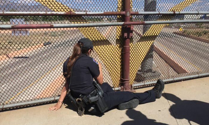 """""""I tried to stay as calm as I could, but to see someone hanging off a bridge, your stomach does drop, you feel that gut feeling,"""" Madrid said, adding that she first had to try and gain the man's trust. (Albuquerque Police Department)"""