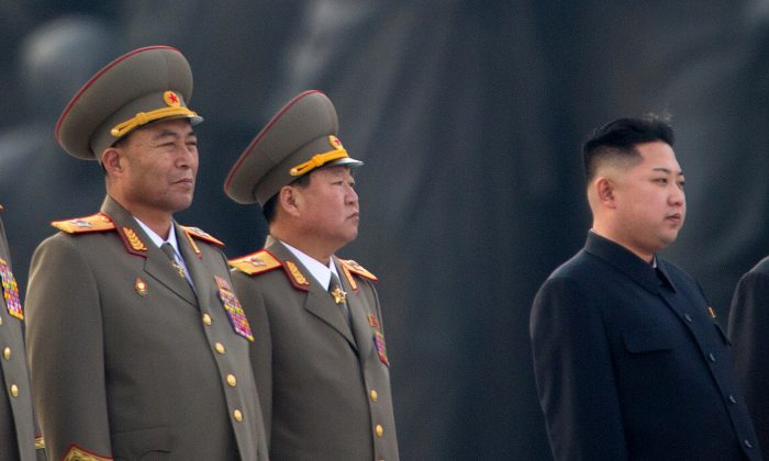 North Korean dictator Kim Jong Un and military leaders during a ceremony in Pyongyang, North Korea, on July 16, 2012. (Ed Jones/AFP/GettyImages)