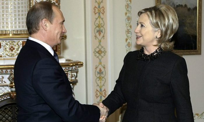 Secretary of State Hillary Clinton (R) shakes hands with Russian Prime Minister Vladimir Putin (L) outside Moscow in Novo-Ogarevo on March 19, 2010. (ALEXEY NIKOLSKY/AFP/Getty Images)