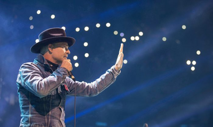Gord Downie performs at WE Day in Toronto on Oct. 19, 2016. The Tragically Hip frontman died Oct. 17, 2017, at the age of 53. (The Canadian Press/Chris Young)